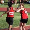 Maniqua Thompson passes the baton to Lexi Brown as the WFHS 4X400 relay team advanced to the finals of the Region 1-4A track meet.  The other two members of the squad are Chloe Thorton and Kaitlin Foran.  The group posted a time of 4:04.39.