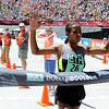 "Ethiopia's Mamitu Daska raises her hands in victory at the finish line in Folsom Field of the Bolder Boulder's Elite Women 10K race on Monday, May 28. For more photos of the race go to  <a href=""http://www.dailycamera.com"">http://www.dailycamera.com</a><br /> Jeremy Papasso/ Camera"