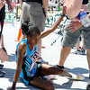 "Kenya's Jelliah Kerubo Tinega collapses at the finish line of the Bolder Boulder Elite Women's 10K race on Monday, May 28. For more photos of the race go to  <a href=""http://www.dailycamera.com"">http://www.dailycamera.com</a><br /> Jeremy Papasso/ Camera"