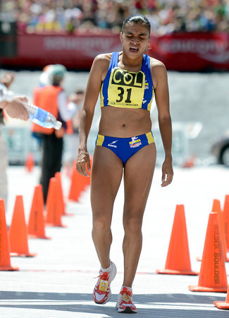 "Team Colorado's Bertha Oliva Sanchez Rivera crosses the finish line exhausted during the Bolder Boulder Elite Women's 10K race  on Monday, May 28. For more photos of the race go to  <a href=""http://www.dailycamera.com"">http://www.dailycamera.com</a><br /> Jeremy Papasso/ Camera"
