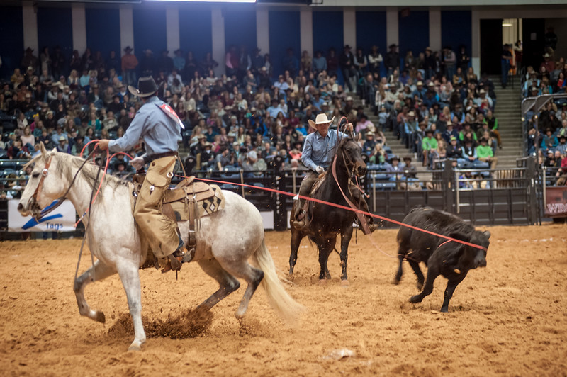 Shaie Williams for Working Sandhill Cattle Co. Tyler Rice header and Riley Smith goes to the horn with double leg during the Stray Gathering at the WRCA 21st World Championship Ranch Rodeo  held at Amarillo Civic Center  in Amarillo, TX  on November 12, 2016.