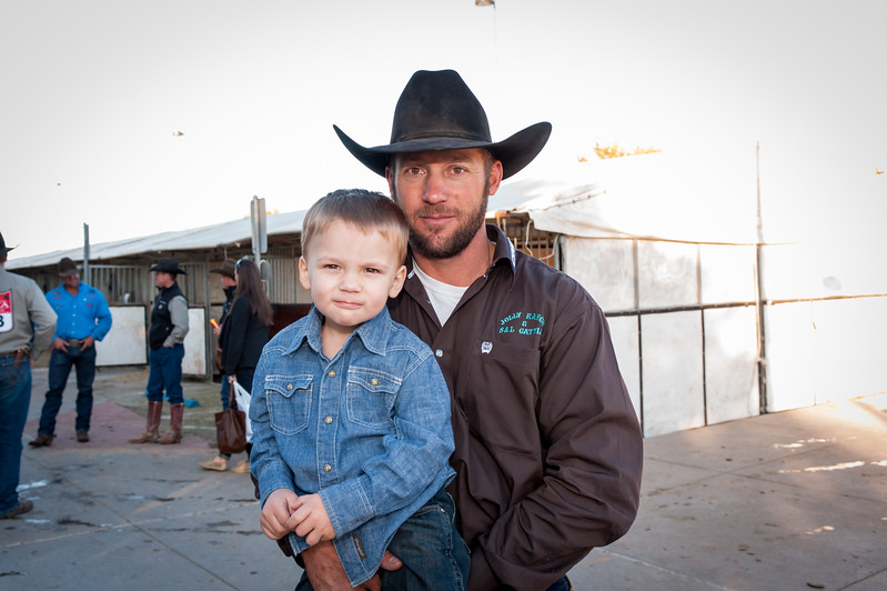 Shaie Williams for Working Ranch Magazine. Nick Peterson with son Tru from the Jolly Ranch and S & L Cattle winners of the WRCA 21st World Championship Ranch Rodeo  held at Amarillo Civic Center  in Amarillo, TX  on November 13, 2016.