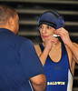 Matt Guarnieri, BHS, adjusts head gear, lost 1st round. February 13th, 2010. Section VIII. Photograph by Kathy Leistner.