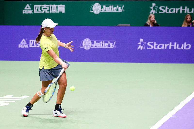Megan SMITH (AUS) in action at the WTA Future Stars U16 Final against Ya Hsin Lee (TPE). Megan Smith won with the final score of 7-5, 1-6, 10-5. (Photo by Sanketa Anand/Sport Singapore)