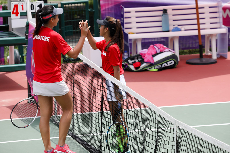 Micaela LAI (SIN) & Tammy TAN (SIN) greeting each other at the end of the U16 Round Robin held at Kallang Tennis Centre, Singapore. (Photo by Sanketa Anand, Sport Singapore)