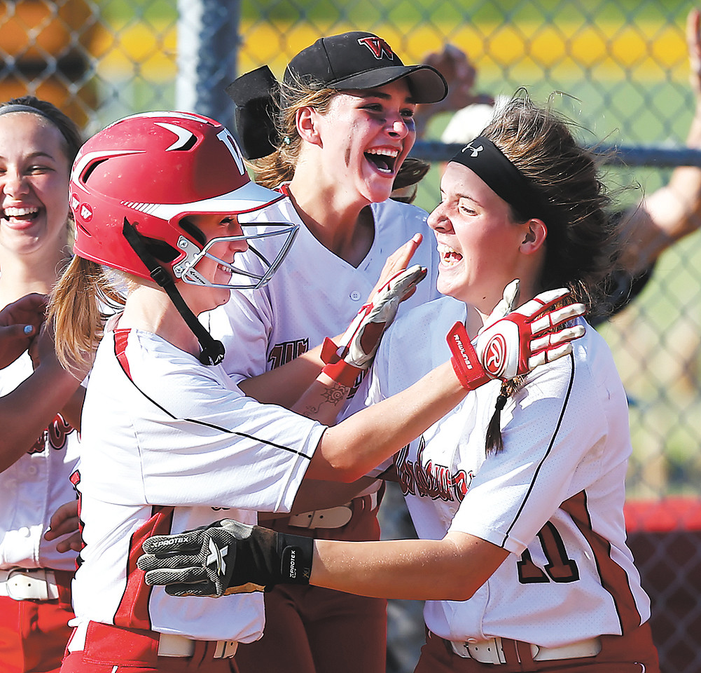 Wadworth's Maddi Long, left, Laura Crookston, center, and Cassidy McDougal celebrate an 8-7 victory over Highland in the Barberton District semi-final game in eight innings. (RON SCHWANE / GAZETTE)