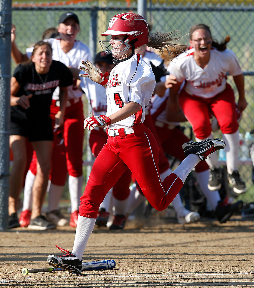 Wadsworth's Cassidy McDougal scores the game winning run against Highland in the eighth inning as the Grizzly bench begins to celebrate. (RON SCHWANE / GAZETTE)