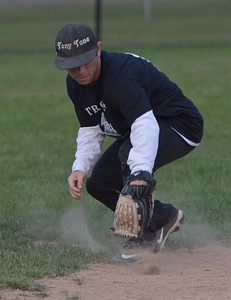 Strong Agency shortstop Tony Willette makes a backhanded stop. (Paula Roberts photo)