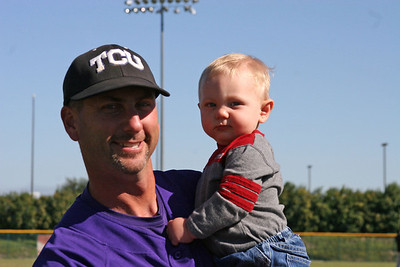 Coach Mazey with his son, Weston, after Saturday's Purple vs White game.