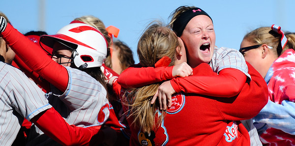 Webb City teammates celebrate at the plate after scoring the winning run in the 8th inning Friday afternoon, Oct. 25, 2013, during the MSHSAA State Championship tournament in Springfield. Webb City won 1-0 and will play again today (Saturday) for the state title.<br /> Globe | T. Rob Brown