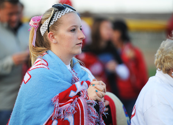 Megan Cornwell, 18, of Webb City, keeps warm with a Webb City Cardinals blanket as she waits for her sister (#14) to come back with the rest of the team following the MSHSAA State Championship game Saturday afternoon, Oct. 26, 2013, in Springfield.<br /> Globe | T. Rob Brown