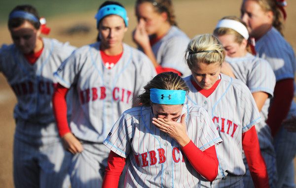 Webb City teammates leave the field following the MSHSAA State Championship game Saturday afternoon, Oct. 26, 2013, in Springfield.<br /> Globe | T. Rob Brown