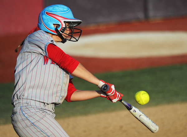 Webb City #21 connects with the ball while batting against Lee's Summit during the MSHSAA State Championship game Saturday afternoon, Oct. 26, 2013, in Springfield.<br /> Globe | T. Rob Brown