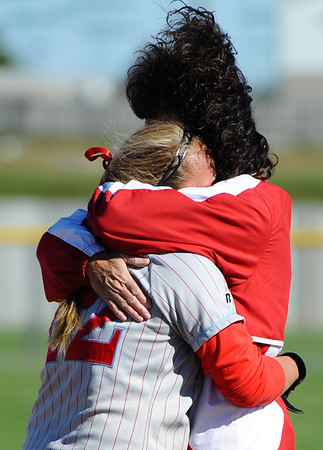 Webb City's Emily Harris gets a hug from her mother, assistant coach Kathy Harris, after winning Friday afternoon, Oct. 25, 2013, during the MSHSAA State Championship tournament in Springfield. Webb City won 1-0 and will play again today (Saturday) for the state title.<br /> Globe | T. Rob Brown