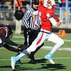 Webb City quarterback Devin Pickett evades the reach of Cape Girardeau's TJ Pearson during the Semi-Final Saturday afternoon, Nov. 23, 2013, at Webb City.<br /> Globe | T. Rob Brown