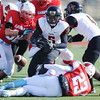Webb City's Royce Clark (23) falls after dislodging the ball from Cape Girardeau wide receiver Nikylus Thompson (5) as Webb City's Easton Carver (98) moves in to assist during the Semi-Final Saturday afternoon, Nov. 23, 2013, at Webb City. The fumble was recovered by Cape Girardeau.<br /> Globe | T. Rob Brown