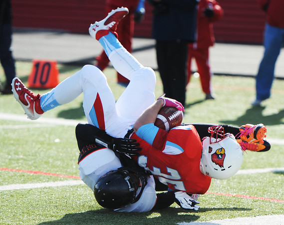 Webb City's Tyler Davison rolls over Cape Girardeau's TJ Pearson through the endzone while scoring a touchdown during the Semi-Final Saturday afternoon, Nov. 23, 2013, at Webb City.<br /> Globe | T. Rob Brown