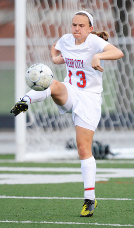 Globe/T. Rob Brown<br /> Webb City's Sydney Philpot takes control of a Carl Junction shot attempt Monday evening, April 8, 2013, at Webb City High School's field.