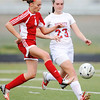 Globe/T. Rob Brown<br /> Carl Junction's Callie Degani (left) steals the ball from Webb City's Abi Rogers Monday evening, April 8, 2013, at Webb City High School's field.