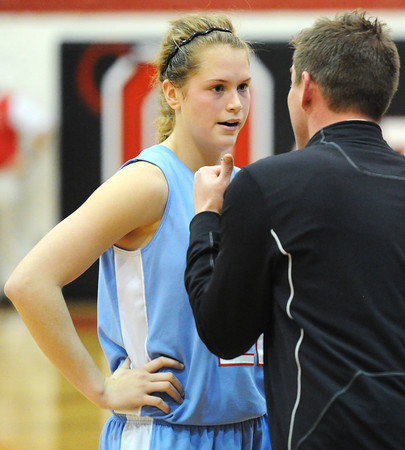 Globe/T. Rob Brown<br /> Webb City's Desirea Buerge speaks with the head coach on the sidelines during Wednesday night's game at Ozark High School's gymnasium against West Plains.