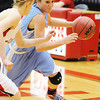 Globe/T. Rob Brown<br /> Webb City's Mikaela Burgess drives the ball around a West Plains defender during Wednesday night's game at Ozark High School's gymnasium.