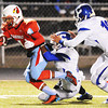 Webb City's Roosevelt Edwards pulls against Carthage defenders EJ Morgan and Alex Derryberry (right) Wednesday night, Nov. 6, 2013, at Webb City's field.<br /> Globe | T. Rob Brown