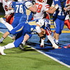 Nick Rubino dives for a touchdown in Newtown's win over Masuk on November 25.