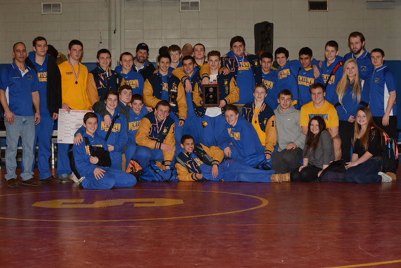 Newtown High School's wrestling team celebrated winning the conference championship on February 14.