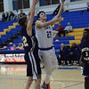 Dylan Palumbo goes up for two points during Newtown's 44-43 comeback victory over visiting Notre Dame-Fairfield on January 20.