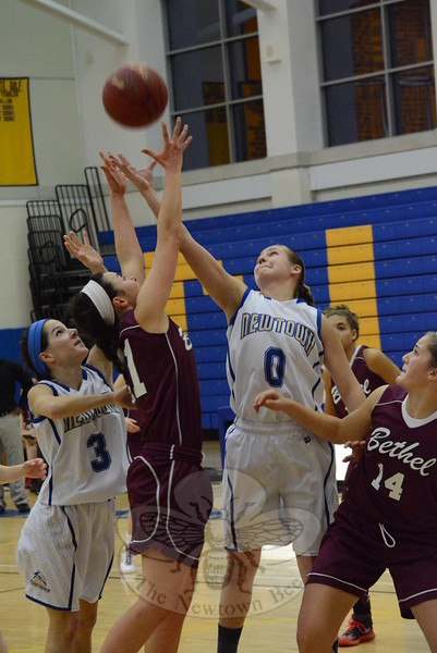 Haley Ryan (No. 3) and Mali Klorczyk (No. 0) battle for a loose ball during Newtown's 43-39 win over visiting Bethel on January 16.