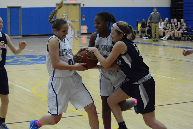 Mali Klorczyk, left, and Olyvia Shaw battle an Immaculate player for control of the ball during Newtown's 38-35 win at home on January 23. Klorczyk led all scorers with 14 points, and Shaw scored the go-ahead basket with 2:13 remaining.