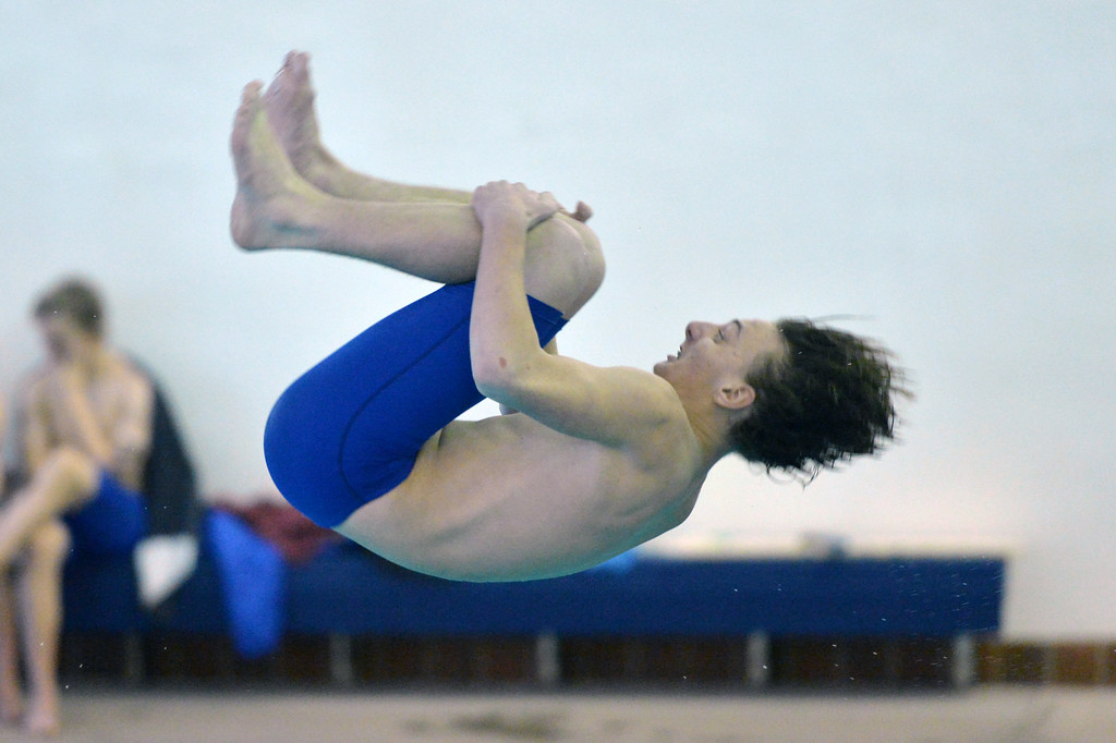 Emmett Potter tucks his knees to his chest during the diving event against Gillette on Thursday, Jan. 26 at Sheridan Junior High School. Mike Pruden | The Sheridan Press