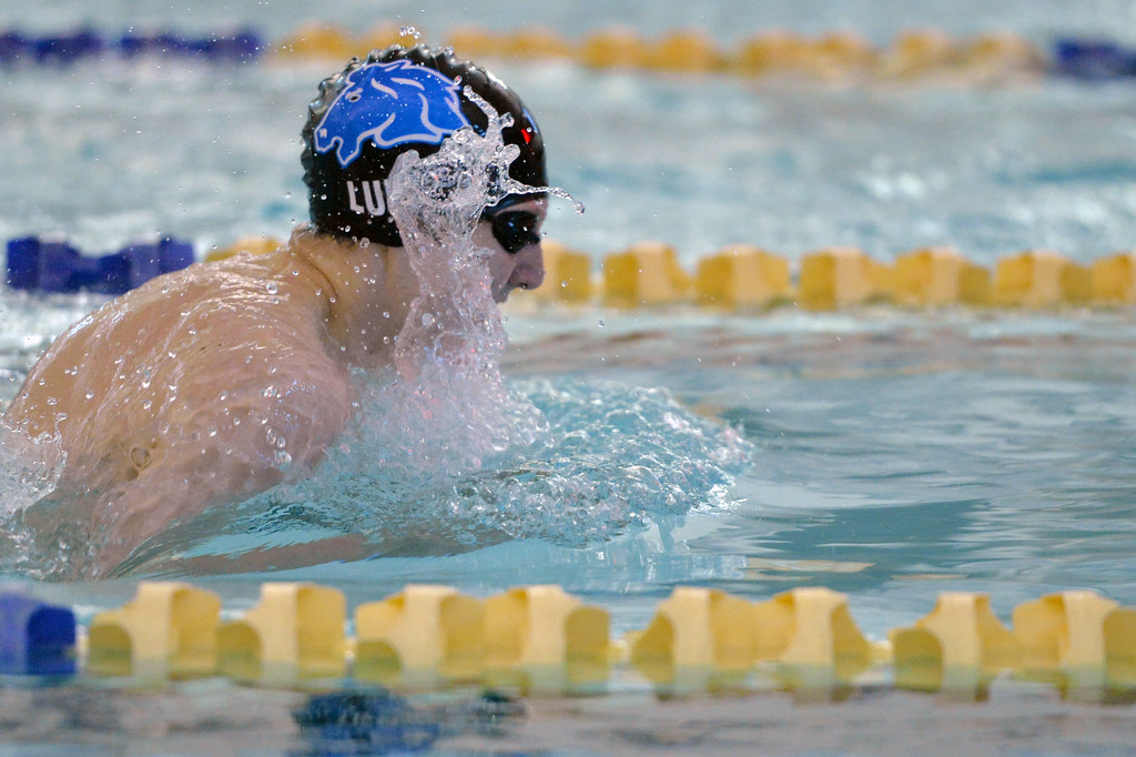 Noah Luhman makes a splash as he takes a stroke in the 100-meter breaststroke during a meet against Gillette on Thursday, Jan. 26 at Sheridan Junior High School. Mike Pruden | The Sheridan Press