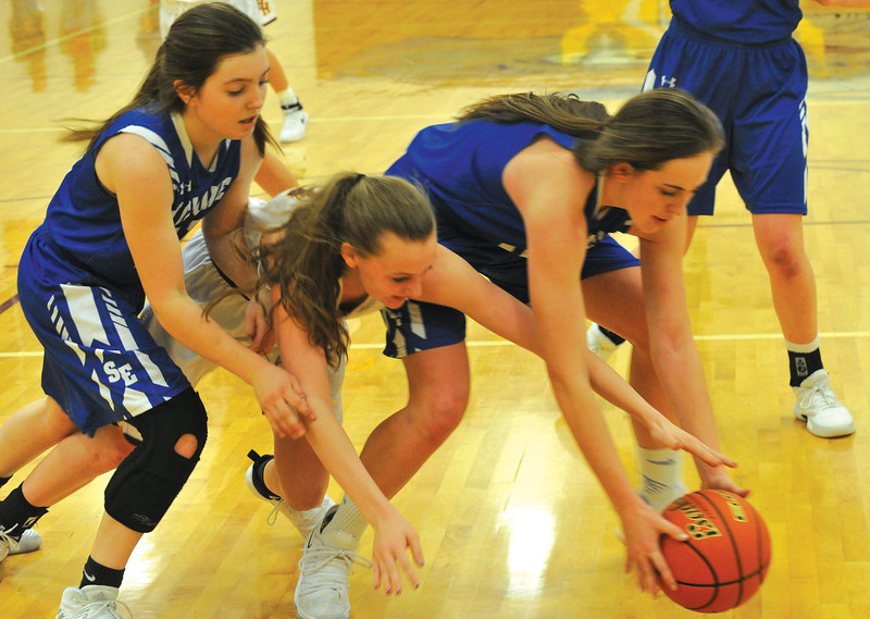 Ryan Patterson | The Sheridan Press<br /> Big Horn's Sydney Schmidt, center, battles for the ball against Southeast's Whitney Foos, left, and Ellie Schmitt in the North-South Challenge at Big Horn High School Saturday, Jan. 6, 2018. The Lady Rams lost 45-39.