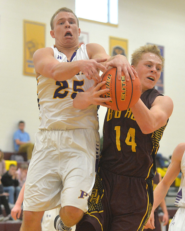 Justin Sheely | The Sheridan Press<br /> Big Horn's Quinn McCafferty, right, rebounds against Pine Bluffs' Hunter Jeffres at Big Horn High School Friday, Jan. 5, 2018. <br /> The Rams lost to Pine Bluffs 59-41.