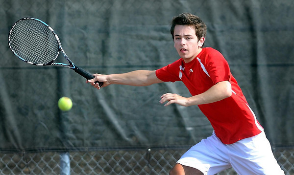 Mankato West's Dan Berry returns a volley during his singles match against Winona Saturday at the West courts.