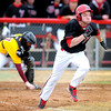 Bethany Lutheran College's Andy Gensch charges toward first base during a bunt attempt in the first game of a doubleheader against Minnesota-Morris Friday.