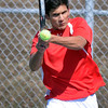 Kieran Townsend returns a volley during Saturday's match at the West courts.  Photo by Pat Christman