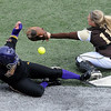 The ball gets past Southwest Minnesota State catcher Kailey Hanson as Minnesota State's Kelly Wood scores a run during the fifth inning of the first game of a double header Wednesday at Gustavus Adolphus College's Hollingsworth Field. Pat Christman