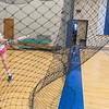 Abby Nicolai, a senior from St. Clair, drives a ball into the netting while working on a drill to hit balls high in the strike zone at practice at Mankato Loyola's Fitzgerald gym on Thursday. St. Clair and Loyola co-opped for the first time in softball this season. Photo by Jackson Forderer