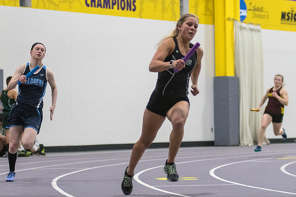 MaeLea Harmon (center) of Waterville-Elysian-Morristown runs the first leg of the 4x200 meter relay at Thursday's track meet held at Myers Field House. The WEM relay team took first place in the race. Photo by Jackson Forderer