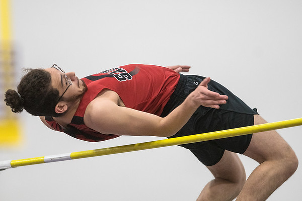 St. James' Bryant Gonzalez clears the bar in the high jump event during Thursday's track and field meet held at Myers Field House on the Minnesota State campus. Photo by Jackson Forderer