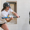 Senior Makenzie Hendley squares to bunt during an indoor practice at Mankato East on Friday. Photo by Jackson Forderer