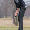 Aiden Brovold of Mankato West makes a birdie putt on the first hole at North Links during team tryouts on Friday. Photo by Jackson Forderer