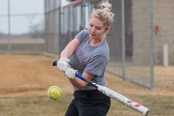 St. Clair/Loyola's Claire Anderson hits the ball in a soft toss drill during the team's practice on Wednesday. Anderson is a senior on the team in their second year of a co-op. Photo by Jackson Forderer