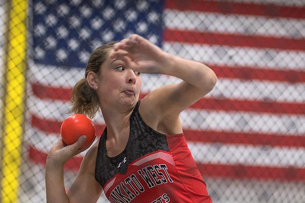 Isabel Lorenz makes a throw in the shot put event during Tuesday's track and field meet held at Myers Field House on the Minnesota State campus. Photo by Jackson Forderer