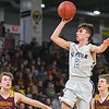Ethan Volk of St. Peter puts up a shot in the Section 2AA championship game played against Jordan at Bresnan Arena on March 15, 2019. Photo by Jackson Forderer