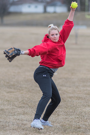 Claire Anderson of St. Clair/Loyola delivers a pitch during practice on Wednesday. Anderson will play the positions of pitcher, catcher and first base for the Spartans. Photo by Jackson Forderer