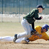 Bemidji State's Jake Braun puts the tag on MSU's Max Waletich during fourth inning action in the first game on Tuesday. Photo by John Cross