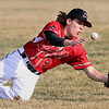 Mankato West's Jayme Munsterman can't bring in a pop fly during the second inning against Rochester John Marshall Thursday at Franklin Rogers Park. Photo by Pat Christman